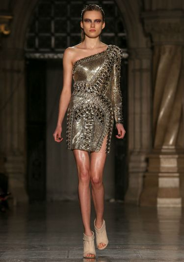 """<p>Look fierce in this heavy metal frock. And a bit like you're wearing very stylish armour, too...</p> <p><a href=""""http://www.cosmopolitan.co.uk/fashion/news/celebs-new-york-fashion-week-aw14"""" target=""""_blank"""">CELEBRITY FASHION WEEK OUTFITS</a></p> <p><a href=""""http://www.cosmopolitan.co.uk/fashion/news/london-fashion-week-street-style-aw14"""" target=""""_blank"""">LONDON FASHION WEEK STREET STYLE</a></p> <p><a href=""""http://www.cosmopolitan.co.uk/fashion/shopping/mulberry-cara-delevingne-handbag-collection"""" target=""""_blank"""">MULBERRY'S CARA DELEVINGNE COLLECTION</a></p>"""