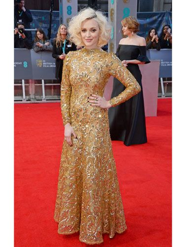 <p>Cosmo fave Fearne Cotton is NEVER boring on the red carpet, and tonight's golden gown is no disappointment. Gorgeous embellishment - and clever long sleeves for the near-freezing temperatures outside.</p>