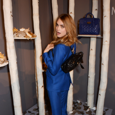 <p>Cara's not juts twerking. She's showing-off one of the fab mini rucksack bags from her new Mulberry collection. WANT.</p>