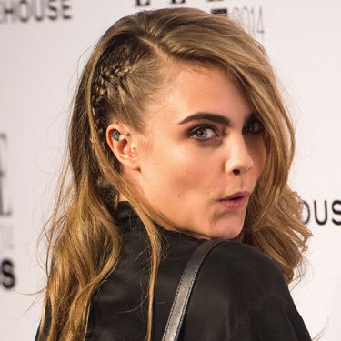 """<p>Aah, Cara's fave&#x3B; the faux-undercut braid. It makes the side-swept waves as gutsy as they are glamorous and shows off her ear tattoo nicely.<span style=""""font-size: 10px&#x3B;""""> </span></p><p><a href=""""http://www.cosmopolitan.co.uk/fashion/news/elle-style-awards-red-carpet-2014"""" target=""""_blank"""">10 AMAZING OUTFITS FROM THE ELLE AWARDS</a></p><p><a href=""""http://www.cosmopolitan.co.uk/beauty-hair/news/trends/celebrity-frow-hair-fashion-week"""" target=""""_self"""">FRONT ROW HAIRSTYLES FROM FASHION WEEK</a></p><p><a href=""""http://www.cosmopolitan.co.uk/beauty-hair/news/styles/hair-trends-spring-summer-2014"""" target=""""_blank"""">HUGE HAIR TRENDS FOR SPRING 2014</a></p>"""