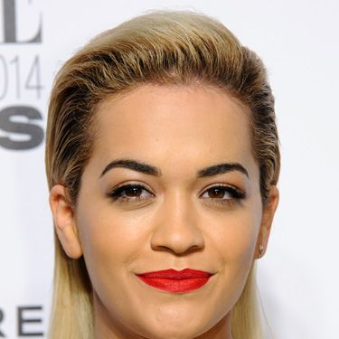 """<p>Rita did dual-texture tresses: wet look at the sides and matte at the back. Well, with a face like that she can pull off directional.</p><p><a href=""""http://www.cosmopolitan.co.uk/fashion/news/elle-style-awards-red-carpet-2014"""" target=""""_blank"""">10 AMAZING OUTFITS FROM THE ELLE AWARDS</a></p><p><a href=""""http://www.cosmopolitan.co.uk/beauty-hair/news/trends/celebrity-frow-hair-fashion-week"""" target=""""_self"""">FRONT ROW HAIRSTYLES FROM FASHION WEEK</a></p><p><a href=""""http://www.cosmopolitan.co.uk/beauty-hair/news/styles/hair-trends-spring-summer-2014"""" target=""""_blank"""">HUGE HAIR TRENDS FOR SPRING 2014</a></p>"""