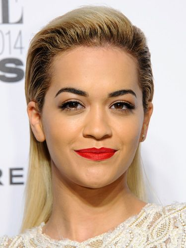 "<p>Rita did dual-texture tresses: wet look at the sides and matte at the back. Well, with a face like that she can pull off directional.</p> <p><a href=""http://www.cosmopolitan.co.uk/fashion/news/elle-style-awards-red-carpet-2014"" target=""_blank"">10 AMAZING OUTFITS FROM THE ELLE AWARDS</a></p> <p><a href=""http://www.cosmopolitan.co.uk/beauty-hair/news/trends/celebrity-frow-hair-fashion-week"" target=""_self"">FRONT ROW HAIRSTYLES FROM FASHION WEEK</a></p> <p><a href=""http://www.cosmopolitan.co.uk/beauty-hair/news/styles/hair-trends-spring-summer-2014"" target=""_blank"">HUGE HAIR TRENDS FOR SPRING 2014</a></p>"