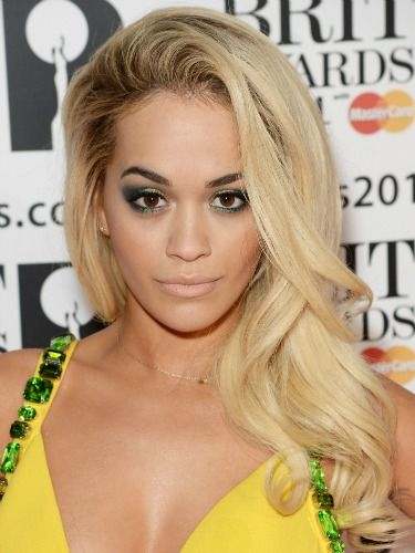"<p>Rita revved up the glamour with her hair full of volume and swept to one side. Her winged aquatic eye makeup looked beautiful against her bejewelled yellow dress.</p> <p><a href=""http://www.cosmopolitan.co.uk/fashion/news/brits-red-carpet-2014"" target=""_blank"">NOW SEE THE BRITS CELEBRITY DRESSES</a></p> <p><a href=""http://www.cosmopolitan.co.uk/beauty-hair/news/styles/celebrity/celebrity-hairstyles-elle-awards-2014"" target=""_self"">OR THE INCREDIBLE ELLE AWARDS HAIRSTYLES</a></p> <p><a href=""http://www.cosmopolitan.co.uk/beauty-hair/news/trends/celebrity-frow-hair-fashion-week"" target=""_self"">AND THE FRONT ROW HAIR WE WANT</a></p> <p><br /><br /></p>"