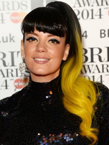 "<p>Ensuring all eyes were on her, Lily showcased a beaming yellow ponytail and went for heavy black eyeliner to mirror her shiny bangs.</p> <p><a href=""http://www.cosmopolitan.co.uk/fashion/news/brits-red-carpet-2014"" target=""_blank"">NOW SEE THE BRITS CELEBRITY DRESSES</a></p> <p><a href=""http://www.cosmopolitan.co.uk/beauty-hair/news/styles/celebrity/celebrity-hairstyles-elle-awards-2014"" target=""_self"">OR THE INCREDIBLE ELLE AWARDS HAIRSTYLES</a></p> <p><a href=""http://www.cosmopolitan.co.uk/beauty-hair/news/trends/celebrity-frow-hair-fashion-week"" target=""_self"">AND THE FRONT ROW HAIR WE WANT</a><br /><br /></p>"