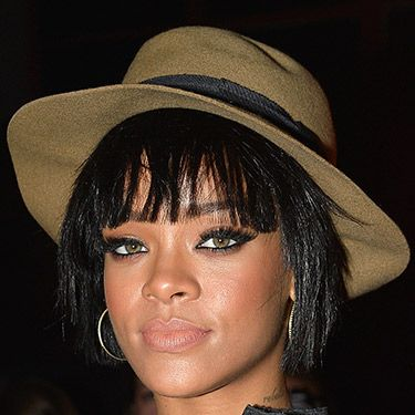 """<p>Rihanna concealed some of her new bob at the Lanvin show in Paris with this cool fedora. From what we see, we love the choppy finish of her feathered fringe and layered locks.</p><p><a href=""""http://www.cosmopolitan.co.uk/beauty-hair/news/trends/hair-makeup-trends-autumn-winter-2014"""" target=""""_blank"""">HOT BEAUTY TRENDS STRAIGHT FROM LFW</a></p><p><a href=""""http://www.cosmopolitan.co.uk/beauty-hair/news/styles/celebrity/cosmo-hairstyle-of-the-day"""" target=""""_blank"""">CHECK OUT COSMO'S HAIRSTYLE OF THE DAY</a></p><p><a href=""""http://www.cosmopolitan.co.uk/beauty-hair/news/styles/hair-trends-spring-summer-2014"""" target=""""_blank"""">HUGE HAIR TRENDS FOR SPRING 2014</a></p>"""
