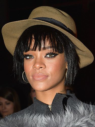 "<p>Rihanna concealed some of her new bob at the Lanvin show in Paris with this cool fedora. From what we see, we love the choppy finish of her feathered fringe and layered locks.</p> <p><a href=""http://www.cosmopolitan.co.uk/beauty-hair/news/trends/hair-makeup-trends-autumn-winter-2014"" target=""_blank"">HOT BEAUTY TRENDS STRAIGHT FROM LFW</a></p> <p><a href=""http://www.cosmopolitan.co.uk/beauty-hair/news/styles/celebrity/cosmo-hairstyle-of-the-day"" target=""_blank"">CHECK OUT COSMO'S HAIRSTYLE OF THE DAY</a></p> <p><a href=""http://www.cosmopolitan.co.uk/beauty-hair/news/styles/hair-trends-spring-summer-2014"" target=""_blank"">HUGE HAIR TRENDS FOR SPRING 2014</a></p>"