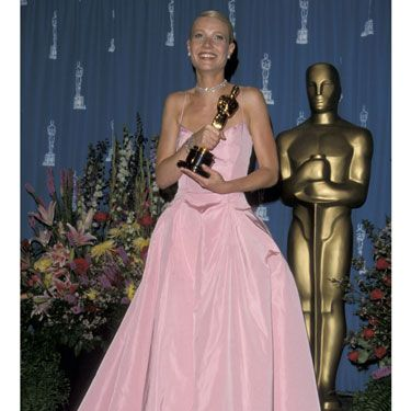 """<div id=""""photo_description"""" class=""""imageInfo""""><p><em class=""""b""""></em>This was the year that Gwyneth cried while picking up the Best Actress Oscar for her role in Shakespeare In Lov<em></em>e. But we were more moved by the dress, <em class=""""b""""></em>a pink taffeta gown by Ralph Lauren. It was VERY Grace Kelly.</p></div><p><a href=""""http://www.cosmopolitan.co.uk/celebs/entertainment/ten-best-ever-oscar-moments"""" target=""""_blank"""">10 GREATEST EVER OSCARS MOMENTS</a></p><p><a href=""""http://www.cosmopolitan.co.uk/fashion/news/every-best-actress-dress-infographic"""" target=""""_blank"""">EVERY BEST ACTRESS DRESS SINCE 1929</a></p><p><a href=""""http://www.cosmopolitan.co.uk/beauty-hair/news/trends/celebrity-beauty/best-oscars-hair-makeup-beauty-ever"""" target=""""_blank"""">THE 13 BEST BEAUTY LOOKS FROM THE OSCARS ARCHIVE</a></p>"""