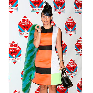 """<p>Lily Allen wore a number of bold pieces on the red carpet, teaming together a colour block Roksanda Illincic dress, white shoes and a furry green and blue jacket. Might as well dress up to win Best Solo Artist, eh?</p><p><a href=""""http://www.cosmopolitan.co.uk/beauty-hair/news/trends/celebrity-beauty/celebrity-beauty-hairstyles-nme-awards-2014"""" target=""""_blank"""">BEST CELEBRITY BEAUTY AT THE NME AWARDS</a></p><p><a href=""""http://www.cosmopolitan.co.uk/fashion/celebrity/best-oscars-red-carpet-dresses-ever"""" target=""""_blank"""">12 BEST OSCAR DRESSES OF ALL TIME</a></p><p><a href=""""http://www.cosmopolitan.co.uk/fashion/news/london-fashion-week-street-style-aw14"""" target=""""_blank"""">STREET STYLE FROM LONDON FASHION WEEK</a></p>"""