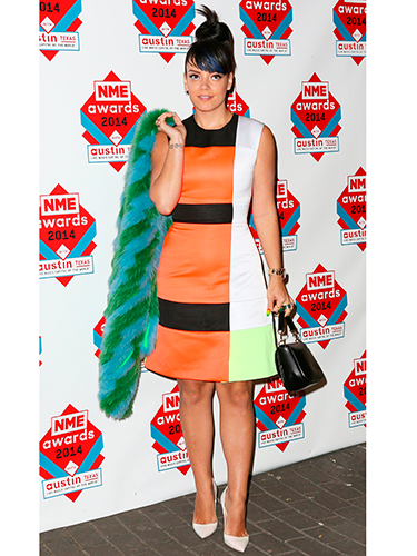 """<p>Lily Allen wore a number of bold pieces on the red carpet, teaming together a colour block Roksanda Illincic dress, white shoes and a furry green and blue jacket. Might as well dress up to win Best Solo Artist, eh?</p> <p><a href=""""http://www.cosmopolitan.co.uk/beauty-hair/news/trends/celebrity-beauty/celebrity-beauty-hairstyles-nme-awards-2014"""" target=""""_blank"""">BEST CELEBRITY BEAUTY AT THE NME AWARDS</a></p> <p><a href=""""http://www.cosmopolitan.co.uk/fashion/celebrity/best-oscars-red-carpet-dresses-ever"""" target=""""_blank"""">12 BEST OSCAR DRESSES OF ALL TIME</a></p> <p><a href=""""http://www.cosmopolitan.co.uk/fashion/news/london-fashion-week-street-style-aw14"""" target=""""_blank"""">STREET STYLE FROM LONDON FASHION WEEK</a></p>"""