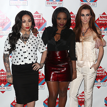"""<p>The former Sugababes haven't quite mastered all looking at the same camera again since reforming, and it looks like they'll be keeping their individual styles as well. There was an array of polka dot, red pleather and sheer fabric on display last night, but they did all go for pointy shoes. </p><p><a href=""""http://www.cosmopolitan.co.uk/beauty-hair/news/trends/celebrity-beauty/celebrity-beauty-hairstyles-nme-awards-2014"""" target=""""_blank"""">BEST CELEBRITY BEAUTY AT THE NME AWARDS</a></p><p><a href=""""http://www.cosmopolitan.co.uk/fashion/celebrity/best-oscars-red-carpet-dresses-ever"""" target=""""_blank"""">12 BEST OSCAR DRESSES OF ALL TIME</a></p><p><a href=""""http://www.cosmopolitan.co.uk/fashion/news/london-fashion-week-street-style-aw14"""" target=""""_blank"""">STREET STYLE FROM LONDON FASHION WEEK</a></p>"""