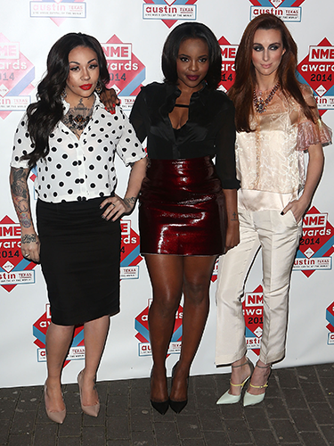 """<p>The former Sugababes haven't quite mastered all looking at the same camera again since reforming, and it looks like they'll be keeping their individual styles as well. There was an array of polka dot, red pleather and sheer fabric on display last night, but they did all go for pointy shoes. </p> <p><a href=""""http://www.cosmopolitan.co.uk/beauty-hair/news/trends/celebrity-beauty/celebrity-beauty-hairstyles-nme-awards-2014"""" target=""""_blank"""">BEST CELEBRITY BEAUTY AT THE NME AWARDS</a></p> <p><a href=""""http://www.cosmopolitan.co.uk/fashion/celebrity/best-oscars-red-carpet-dresses-ever"""" target=""""_blank"""">12 BEST OSCAR DRESSES OF ALL TIME</a></p> <p><a href=""""http://www.cosmopolitan.co.uk/fashion/news/london-fashion-week-street-style-aw14"""" target=""""_blank"""">STREET STYLE FROM LONDON FASHION WEEK</a></p>"""
