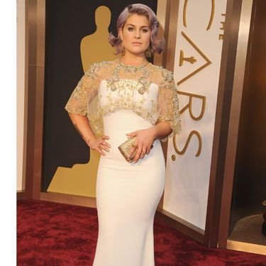 <p>Something of a bridal vibe to Kelly O's dress, we're loving the elegant, flapper-style embellishment over her shoulders.<br /><br />Gorgeous.</p>