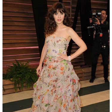 """<p>Ruffles and florals. Sounds like your nan's curtains, but IRL, Zooey Deschanel makes her 'out there' Oscar de la Renta dress totally work, and we salute her style.</p><p><strong>MORE OSCARS STUFF YOU NEED IN YOUR LIFE:</strong></p><p><a href=""""http://www.cosmopolitan.co.uk/fashion/news/oscars-2014-red-carpet-dresses"""" target=""""_blank"""">OSCARS 2014: RED CARPET ARRIVALS<strong></strong></a></p><p><a href=""""http://www.cosmopolitan.co.uk/fashion/news/oscars-2014-best-dressed"""" target=""""_blank"""">THE 5 BEST DRESSES AT THE OSCARS 2014</a></p><p><a href=""""http://www.cosmopolitan.co.uk/celebs/entertainment/oscars-2014-winners"""" target=""""_blank"""">OSCARS 2014: THE FULL LIST OF WINNERS</a></p><p><a href=""""http://www.cosmopolitan.co.uk/fashion/news/every-best-actress-dress-infographic"""" target=""""_blank"""">EVERY BEST ACTRESS WINNER'S OSCARS DRESS SINCE 1929</a></p><p> </p><div style=""""overflow: hidden&#x3B; color: #000000&#x3B; background-color: #ffffff&#x3B; text-align: left&#x3B; text-decoration: none&#x3B;""""> </div>"""