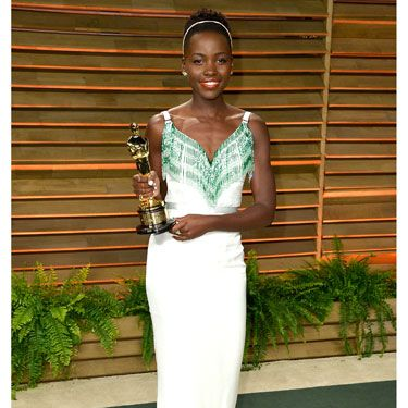 """<p>Lupita wore her second Miuccia Prada dress of the evening, changing into a sassy Miu Miu gown, trimmed with green beaded fringing along the neckline. She accessorised with matching Prada silk peep-toe sandals - and her Oscar, of course.</p><p><strong>MORE OSCARS STUFF YOU NEED IN YOUR LIFE:</strong></p><p><a href=""""http://www.cosmopolitan.co.uk/fashion/news/oscars-2014-red-carpet-dresses"""" target=""""_blank"""">OSCARS 2014: RED CARPET ARRIVALS<strong></strong></a></p><p><a href=""""http://www.cosmopolitan.co.uk/fashion/news/oscars-2014-best-dressed"""" target=""""_blank"""">THE 5 BEST DRESSES AT THE OSCARS 2014</a></p><p><a href=""""http://www.cosmopolitan.co.uk/celebs/entertainment/oscars-2014-winners"""" target=""""_blank"""">OSCARS 2014: THE FULL LIST OF WINNERS</a></p><p><a href=""""http://www.cosmopolitan.co.uk/fashion/news/every-best-actress-dress-infographic"""" target=""""_blank"""">EVERY BEST ACTRESS WINNER'S OSCARS DRESS SINCE 1929</a></p>"""
