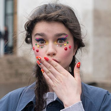 """<p>Model Dasha Bilyuk was showcasing the Manish Arora catwalk style on the streets, and we liked what we see. Her multi-coloured makeup and matching nail art was young, fun and flirty. Nice to note that pigtail plaits are catching on too.</p><p><a href=""""http://www.cosmopolitan.co.uk/beauty-hair/news/trends/hair-makeup-trends-autumn-winter-2014"""" target=""""_self"""">BIG BEAUTY TRENDS FROM PARIS FASHION WEEK</a></p><p><a href=""""http://www.cosmopolitan.co.uk/beauty-hair/news/trends/celebrity-frow-hair-fashion-week"""" target=""""_self"""">FRONT ROW HAIRSTYLES - FASHION WEEK AW14</a></p><p><a href=""""http://www.cosmopolitan.co.uk/beauty-hair/news/trends/celebrity-beauty/celebrity-nail-art-manicures"""" target=""""_self"""">CELEBRITY NAIL ART MANICURE PICTURES</a></p>"""