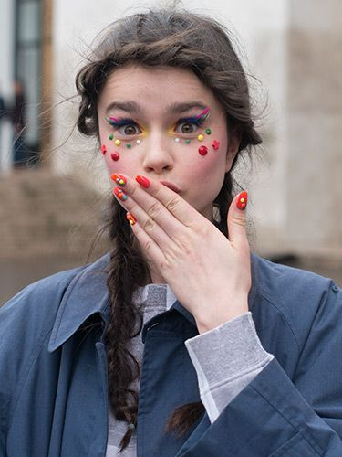 """<p>Model Dasha Bilyuk was showcasing the Manish Arora catwalk style on the streets, and we liked what we see. Her multi-coloured makeup and matching nail art was young, fun and flirty. Nice to note that pigtail plaits are catching on too.</p> <p><a href=""""http://www.cosmopolitan.co.uk/beauty-hair/news/trends/hair-makeup-trends-autumn-winter-2014"""" target=""""_self"""">BIG BEAUTY TRENDS FROM PARIS FASHION WEEK</a></p> <p><a href=""""http://www.cosmopolitan.co.uk/beauty-hair/news/trends/celebrity-frow-hair-fashion-week"""" target=""""_self"""">FRONT ROW HAIRSTYLES - FASHION WEEK AW14</a></p> <p><a href=""""http://www.cosmopolitan.co.uk/beauty-hair/news/trends/celebrity-beauty/celebrity-nail-art-manicures"""" target=""""_self"""">CELEBRITY NAIL ART MANICURE PICTURES</a></p>"""