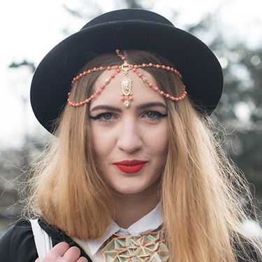 """<p>Fashion Blogger Elisa Baudoin dresses her tresses with an Indian-inspired tikka headpiece from ASOS. The exaggerated eyeliner and bold red lippy offset it a treat.</p><p><a href=""""http://www.cosmopolitan.co.uk/beauty-hair/news/trends/hair-makeup-trends-autumn-winter-2014"""" target=""""_self"""">BIG BEAUTY TRENDS FROM PARIS FASHION WEEK</a></p><p><a href=""""http://www.cosmopolitan.co.uk/beauty-hair/news/trends/celebrity-frow-hair-fashion-week"""" target=""""_self"""">FRONT ROW HAIRSTYLES - FASHION WEEK AW14</a></p><p><a href=""""http://www.cosmopolitan.co.uk/beauty-hair/news/trends/celebrity-beauty/celebrity-nail-art-manicures"""" target=""""_self"""">CELEBRITY NAIL ART MANICURE PICTURES</a></p>"""