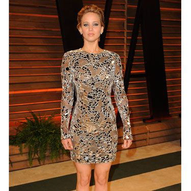 <p>JLaw decided to avoid troublesome long hemlines and switched to a metallic minidress by Tom Ford, to no doubt bust some serious moves on the dance floor.<strong><br /></strong></p>