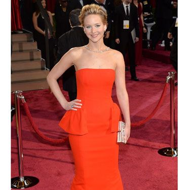 <p>Jennifer Lawrence. A Dior dress. An embarrassing fall. It's like the 2013 Oscars all over again! We weren't surprised to see her take a tumble - her Brian Atwood heels were MEGA high. Dressed in Dior, of course, the red strapless gown with peplum detail made JLaw look as statuesque as an Oscar. A Ferragamo clutch and dazzling necklace finished her look.</p>