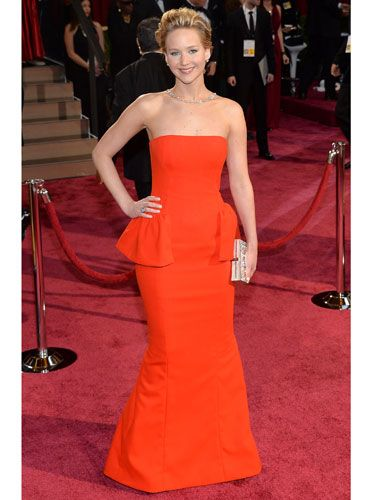 "<p>Jennifer Lawrence. A Dior dress. An embarrassing fall. It's like the 2013 Oscars all over again! We weren't surprised to see her take a tumble - her Brian Atwood heels were MEGA high. Dressed in Dior, of course, the red strapless gown with peplum detail made JLaw look as statuesque as an Oscar. A Ferragamo clutch and dazzling necklace finished her look.</p> <p><a href=""http://www.cosmopolitan.co.uk/fashion/news/oscars-2014-red-carpet-dresses"" target=""_blank"">OSCARS 2014: RED CARPET ARRIVALS<strong></strong></a></p> <p><a href=""http://www.cosmopolitan.co.uk/fashion/news/oscars-2014-best-dressed"" target=""_blank"">THE 5 BEST DRESSES AT THE OSCARS 2014</a></p> <p><a href=""http://www.cosmopolitan.co.uk/fashion/news/every-best-actress-dress-infographic"" target=""_blank"">EVERY BEST ACTRESS WINNER'S OSCARS DRESS SINCE 1929</a></p> <div style=""overflow: hidden; color: #000000; background-color: #ffffff; text-align: left; text-decoration: none;""> </div>"