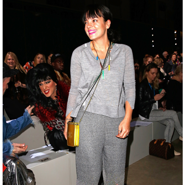 <p>OK, the sports luxe trend just got REAL. Lily Allen's sequin sweats (by Ashish, to wear to his show) are SPEAKING TO US. The sparkly stilettos and assorted Chanel pouches in neon are the finishing touches for this laid-back look.</p>