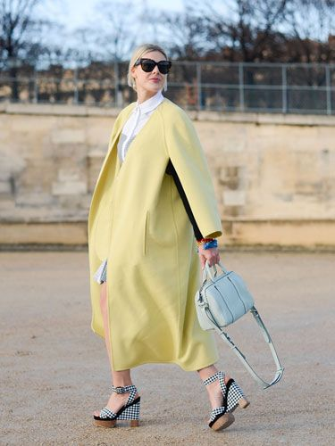 "<p>'Who me? Oh, I'm just busy looking like a delicious pile of French macaroons in my lemon sorbet coat, mint green handbag and statement heels. That's all...'</p> <p><a href=""http://www.cosmopolitan.co.uk/fashion/news/celebs-new-york-fashion-week-aw14"" target=""_blank"">NOW SEE WHAT THE CELEBS ARE WEARING ON THE FROW</a></p> <p><a href=""http://www.cosmopolitan.co.uk/fashion/news/new-york-fashion-week-street-style-aw14"" target=""_blank"">STREET STYLE FROM NEW YORK FASHION WEEK</a></p> <p><a href=""http://www.cosmopolitan.co.uk/fashion/news/london-fashion-week-street-style-aw14"" target=""_blank"">LONDON FASHION WEEK STREET STYLE</a></p> <div style=""overflow: hidden; color: #000000; background-color: #ffffff; text-align: left; text-decoration: none;""> </div>"