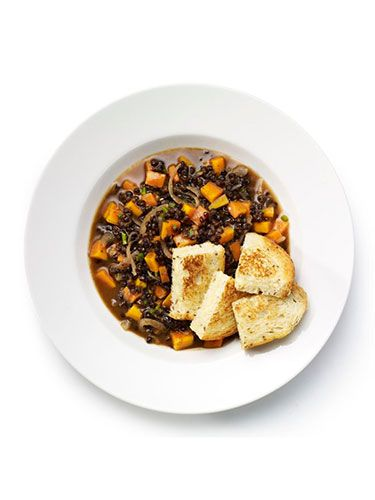"""<p><strong>Quick lentil casserole with cheese croutons</strong></p> <p>1. In a small flameproof casserole dish, soften 1 sliced red onion and 1 chopped carrot with 1tbsp oil over a medium heat. Add 1 chopped green chilli at the last minute.<br />2. Stir in 200ml vegetable stock, 1dsp tomato purée and season.<br />3. Bring to simmer, put the lid on and cook for 15 minutes. Stir in half the lentils and cook for 5 minutes.<br />4. Meanwhile, make the croutons. Sandwich two thinly-sliced pieces of bread with grated cheese. Fry in a little oil over a medium-high heat, turning over until both sides of the sandwich are golden.<br />5. Cut the crouton sandwich into four and serve with the casserole.</p> <p><em>Optional extra: Add 1 tsp ground cumin with the chilli.</em></p> <p> </p> <p><a href=""""http://www.cosmopolitan.co.uk/diet-fitness/diets/healthy-eating-on-a-budget"""" target=""""_blank"""">EAT WELL FOR UNDER £15 SHOPPING LIST</a></p> <p><a href=""""http://www.cosmopolitan.co.uk/diet-fitness/diets/comfort-food-recipes-under-300-calories"""" target=""""_blank"""">COMFORT FOOD UNDER 300 CALORIES</a></p> <p><a href=""""http://www.cosmopolitan.co.uk/diet-fitness/diets/how-to-eat-healthy"""" target=""""_blank"""">7 STEPS TO A HEALTHIER LIFESTYLE</a></p>"""