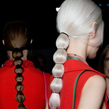 """<p>If you don't have super-long hair, part your locks horizontally along the middle and nestle some extensions in. Straighten and smooth your hair into a low ponytail. Follow Redken creative consultant Guido Palau's lead and place thin elastic bands every two inches down the ponytail and gently tease the hair out between each band. Fix with a hairspray like Redken Forceful 23 Super Strength Finish Spray.</p><p><a href=""""http://www.cosmopolitan.co.uk/beauty-hair/news/trends/hair-makeup-trends-autumn-winter-2014"""" target=""""_self"""">MORE BEAUTY TRENDS FROM FASHION WEEK AW14</a></p><p><a href=""""http://www.cosmopolitan.co.uk/beauty-hair/news/styles/hair-trends-spring-summer-2014"""" target=""""_self"""">THE TOP 10 HAIRSTYLE TRENDS FOR 2014</a></p><p><a href=""""http://www.cosmopolitan.co.uk/beauty-hair/news/styles/spring_summer-2014-hair-colour-trends"""" target=""""_self"""">SPRING/SUMMER HAIR COLOUR TRENDS</a></p>"""