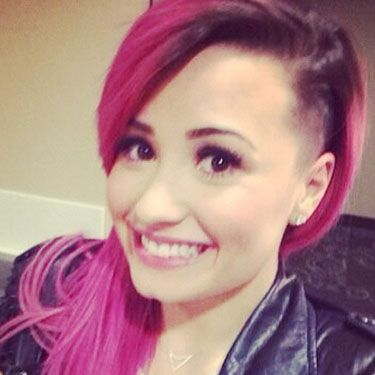 """<p>Demi Lovato may be on tour right now in the United States, but the Skyscraper singer still found time for a major hair shakeup. The X Factor USA judge shaved the side of her head and - thankfully! - posted her new look to Instagram. """"<span><span data-reactid="""".r[0].[0].[1].[0].[0].[0].[0].[0].[0]""""><span data-reactid="""".r[0].[0].[1].[0].[0].[0].[0].[0].[0].[1].[1].[0].[0].[0].[0].[1].[2][1]""""><span data-reactid="""".r[0].[0].[1].[0].[0].[0].[0].[0].[0].[1].[1].[0].[0].[0].[0].[1].[2][1].[0]"""">IDGAF</span></span></span></span>,"""" she wrote, along with emojis and <span class=""""st"""">#NEONLIGHTSTOUR.</span></p><p><a href=""""http://www.cosmopolitan.co.uk/celebs/celebrity-gossip/oscars-week-2014-celebrity-gossip"""" target=""""_blank"""">INSIDE THE OSCARS PARTIES</a></p><p><a href=""""http://www.cosmopolitan.co.uk/celebs/celebrity-gossip/celebrity-twitter-instagram-bafta-photos"""" target=""""_blank"""">THE BAFTAS IN CELEBRITY INSTAGRAMS</a></p><p><a href=""""http://www.cosmopolitan.co.uk/celebs/celebrity-gossip/matthew-mcconaughey-school-prom-photo"""" target=""""_blank"""">MATTHEW MCCONAUGHEY'S PROM PIC GOES VIRAL</a></p>"""