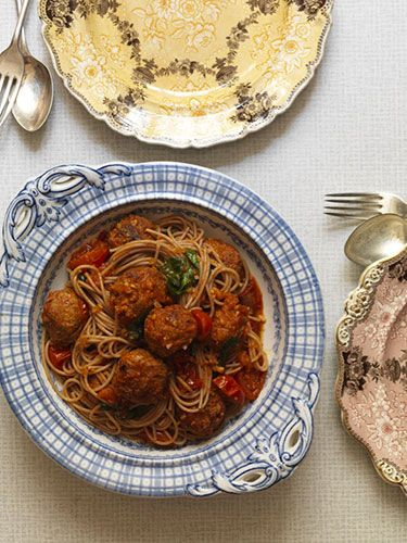 """<p>Serves 4</p> <p><strong>Ingredients</strong><br />200g lean minced pork (10% fat)<br />150g fresh chorizo sausage, the meat extracted from the skin<br />1 small onion, finely chopped<br />A few sprigs of oregano, leaves removed<br />Sea salt and freshly ground black pepper<br />Olive oil spray<br />320g spelt spaghetti</p> <p><em>For the sauce</em><br />1 small dried red chilli<br />½ tsp fennel seeds<br />4 garlic cloves<br />2 tsp olive oil<br />1 small onion, finely chopped<br />800g vine-ripened tomatoes, halved<br />1 tsp red-wine vinegar<br />A pinch of sugar<br />A handful of fresh basil leaves</p> <p><strong>Method</strong><br />Put the minced pork, chorizo, onion, oregano, and a pinch of salt and pepper in a bowl and mix the lot together with your hands (the chorizo takes a bit of work as it's much firmer than the pork mince). Divide into 12 balls. Pop them on a baking tray, cover with clingfilm and set aside to chill in the fridge.</p> <p>Meanwhile, make the sauce. Bash the chilli, fennel and garlic together in a pestle and mortar until they break down. Heat the oil in a pan, then add the onions and cook slowly for 8–10 minutes, or until the onions have softened and started to go golden. Add in the crushed garlic, chilli and fennel seeds and fry for 2 minutes. Tip in the tomatoes, add the vinegar and sugar and simmer very gently, uncovered, for about 20 minutes.</p> <p>Spritz a non-stick frying pan with a little olive oil, then add the meatballs and fry gently over a low heat for 10 minutes, turning them over once. (You may need to do this in batches if your pan is not very big.) Drain off any excess fat, pour in the sauce and cook for a further 15 minutes, then stir through the basil.</p> <p>Meanwhile, bring a big saucepan of salted water to the boil, add the pasta and cook for 7 minutes, or until al dente. Stir the sauce and meatballs through the pasta and divide equally among bowls.</p> <p> </p> <p><a href=""""http://www.cosmopolitan.co.uk/diet-fitness/"""