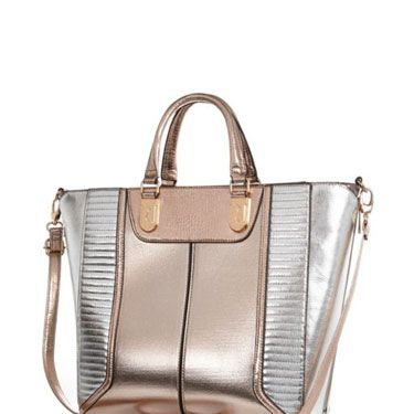 """<p>Add a sheen to your look - literally - with a metallic tote bag&#x3B; big enough to cart around all your stuff and totally on trend, too.</p><p>Metallic tote bag, £45, <a href=""""http://www.riverisland.com/women/bags--purses/shopper--tote-bags/Rose-gold-metallic-colour-block-tote-bag-651309"""" target=""""_blank"""">riverisland.com</a></p><p><a href=""""http://www.cosmopolitan.co.uk/fashion/shopping/spring-shoes-fashion-high-street"""" target=""""_blank"""">STEP INTO NEW SEASON: 10 PAIRS OF SPRING-LIKE SHOES</a></p><p><a href=""""http://www.cosmopolitan.co.uk/fashion/shopping/handbags-spring-fashion-high-street"""" target=""""_blank"""">NEW SEASON ARM CANDY: 12 HOT HANDBAGS</a></p><p><a href=""""http://www.cosmopolitan.co.uk/fashion/shopping/spring-fashion-trends-2014?page=1"""" target=""""_blank"""">7 BIG FASHION TRENDS FOR SPRING 2014</a></p>"""