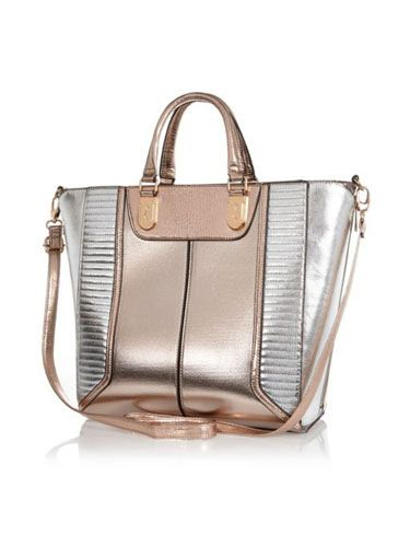 """<p>Add a sheen to your look - literally - with a metallic tote bag; big enough to cart around all your stuff and totally on trend, too.</p> <p>Metallic tote bag, £45, <a href=""""http://www.riverisland.com/women/bags--purses/shopper--tote-bags/Rose-gold-metallic-colour-block-tote-bag-651309"""" target=""""_blank"""">riverisland.com</a></p> <p><a href=""""http://www.cosmopolitan.co.uk/fashion/shopping/spring-shoes-fashion-high-street"""" target=""""_blank"""">STEP INTO NEW SEASON: 10 PAIRS OF SPRING-LIKE SHOES</a></p> <p><a href=""""http://www.cosmopolitan.co.uk/fashion/shopping/handbags-spring-fashion-high-street"""" target=""""_blank"""">NEW SEASON ARM CANDY: 12 HOT HANDBAGS</a></p> <p><a href=""""http://www.cosmopolitan.co.uk/fashion/shopping/spring-fashion-trends-2014?page=1"""" target=""""_blank"""">7 BIG FASHION TRENDS FOR SPRING 2014</a></p>"""