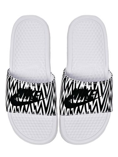 <p>We couldn't quite get our head around the pool slides trend until we saw these bad boys. Slightly more slimline than other styles we've seen and we love the graphic print, too.</p>
