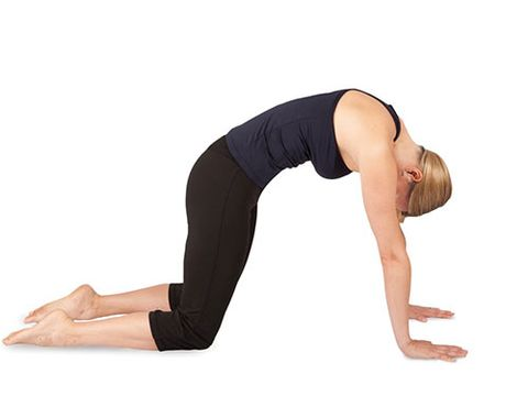 "<p><strong>This move mobilises the spine and opens the lower back to increase blood flow and thereby reduce bloating.</strong></p> <p>Kneel with your knees and hands on your mat, aligning hands under shoulders and knees under hips. Ensure the spine is in a neutral position and the abdomen is lifted.</p> <p>Round your lower back, bringing your tailbone through your legs and nodding your chin towards your chest into a cat-like position.</p> <p>Return to neutral position leading with the tailbone.</p> <p>Draw your shoulder blades down, lift your head and your 'sitz' or sitting bones into a cow-like position.</p> <p>Alternate between cat/cow 5 times, maintaining your own flow and speed.<a href=""http://www.cosmopolitan.co.uk/diet-fitness/fitness/at-home-workout-that-girl-charli-cohen-christina-howells"" target=""_blank""><em><br /><br /></em>THE BUSY GIRL'S WORKOUT</a></p> <p><a href=""http://www.cosmopolitan.co.uk/diet-fitness/fitness/the-benefits-of-pilates"" target=""_blank"">WHY WE LOVE PILATES</a></p> <p><a href=""http://www.cosmopolitan.co.uk/diet-fitness/fitness/the-benefits-of-spinning"" target=""_blank"">GET YOUR SPIN ON </a></p>"
