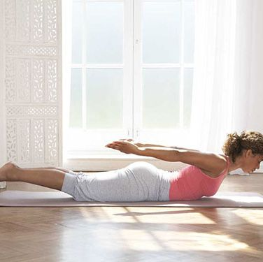 """<p><strong>The swallow dive</strong><br />Stimulates circulation in your abdomen and digestive organs, helping to flatten your tum as well as hone your glutes, hamstrings and back.</p><p>1. Lie face down with your arms at your sides, palms up. Breathe in and raise your head, chest, legs and arms as high as is comfortable.<br />2. Keeping your abs pulled in, hold for five breaths, then release. Repeat three times.</p><p><a href=""""http://www.cosmopolitan.co.uk/diet-fitness/fitness/yoga-poses-that-ease-aches-and-pains"""" target=""""_blank"""">THE YOGA POSES YOU NEED TO KNOW</a></p><p><a href=""""http://www.cosmopolitan.co.uk/diet-fitness/fitness/flatten-your-stomach-with-pilates"""" target=""""_blank"""">FLATTEN YOUR STOMACH WITH PILATES</a></p><p><a href=""""http://www.cosmopolitan.co.uk/diet-fitness/fitness/tampax-fitness-resolution-essentials"""" target=""""_blank"""">HOW TO KEEP YOUR FITNESS RESOLUTIONS</a></p>"""