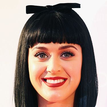 """<p>Katy Perry's cartoony haircut is utterly of-the-moment. She perfectly executes a blunt bob with a short fringe and quirky accessory. If you're brave enough to try the Lego-look, show this to your hairdresser.</p><p><a href=""""http://www.cosmopolitan.co.uk/beauty-hair/news/styles/spring_summer-2014-hair-colour-trends"""" target=""""_self"""">THREE HOT HAIR COLOUR TRENDS FOR SS14</a></p><p><a href=""""http://www.cosmopolitan.co.uk/beauty-hair/news/styles/hair-trends-spring-summer-2014"""" target=""""_self"""">THE HUGE HAIRSTYLE TRENDS FOR 2014</a></p><p><a href=""""http://www.cosmopolitan.co.uk/beauty-hair/news/styles/easy-catwalk-hairstyles-to-copy"""" target=""""_blank"""">6 SIMPLE CATWALK HAIRSTYLES TO TRY</a></p>"""