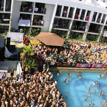 "If you're part of this Massive, it means you'll spend most of your holiday in San Antonio (well, dur). Es Paradis, Eden, and Ibiza Rocks are all in this part of town and you'll need somewhere to stay that's right in the action. And where better than the Ibiza Rocks Hotel? The hotel is the venue for the world famous Ibiza Rocks gigs, showcasing the biggest names in live music and W.A.R! where the world's best DJ's take over the stage every Friday. Gigs are included in your booking too and each year huge names take to the stage. <strong>Do it!</strong> Prices start from £135 per night, <a href=""http://www.ibizarocks.com/hotel/"" target=""_blank"">Ibiza Rocks</a>.</p>"