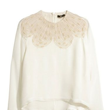 <p>If you're looking for a step beyond the white shirt, try this beautiful beaded blouse from H&M, which tap's into this season's laidback boho vibes a treat.</p>