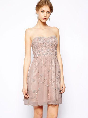 """<p>There's nothing like a scattering of embellishment to make a frock sing, especially when offset with a peach-nude shade (stops it from looking OTT). This Frock and Frill number has an Art Deco feel, and you'll be reaching for it long after the wedding.</p> <p>Frock and Frill embellished dress, £135, <a href=""""http://www.asos.com/Frock-and-Frill/Frock-and-Frill-Embellished-Bandeau-Skater-Dress/Prod/pgeproduct.aspx?iid=3669485&cid=15156&sh=0&pge=0&pgesize=-1&sort=-1&clr=Dusky+pink"""" target=""""_blank"""">Asos.com</a></p> <p><a href=""""http://www.cosmopolitan.co.uk/fashion/shopping/wedding-dress-trends-2014%2010%20"""" target=""""_blank"""">SS14 WEDDING DRESS TRENDS</a></p> <p><a href=""""http://www.cosmopolitan.co.uk/fashion/shopping/top-ten-wedding-dresses-on-film%20"""" target=""""_blank"""">BEST WEDDING DRESSES FROM THE FILMS</a></p> <p><a href=""""http://www.cosmopolitan.co.uk/blogs/cosmo-blog-awards-2013/rock-n-roll-bride-best-alternative-wedding-ideas-photos-tattoos-blog-awards?click=main_sr"""" target=""""_blank"""">ROCK N ROLL BRIDE'S BEST EVER WEDDINGS</a></p>"""