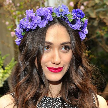 """<p>How's this for Coachella hair inspo? Emmy nailed hippy chic in LA with undone waves and a crown of flowers. Her vibrant magenta lip sealed the deal.</p><p><a href=""""http://www.cosmopolitan.co.uk/beauty-hair/news/trends/celebrity-beauty/lupita-nyong-for-lancome-pictures"""" target=""""_self"""">SEE LUPITA NYONG'O AS THE FACE OF LANCOME</a></p><p><a href=""""http://www.cosmopolitan.co.uk/beauty-hair/news/trends/celebrity-beauty/beyonce-makeup-artist-sir-john-tips"""" target=""""_blank"""">BEYONCE'S MAKEUP ARTIST SHARES HIS TIPS</a></p><p><a href=""""http://www.cosmopolitan.co.uk/beauty-hair/news/styles/celebrity/celebrity-bob-hairstyles"""" target=""""_blank"""">THE BEST CELEBRITY BOB HAIRSTYLES</a></p>"""