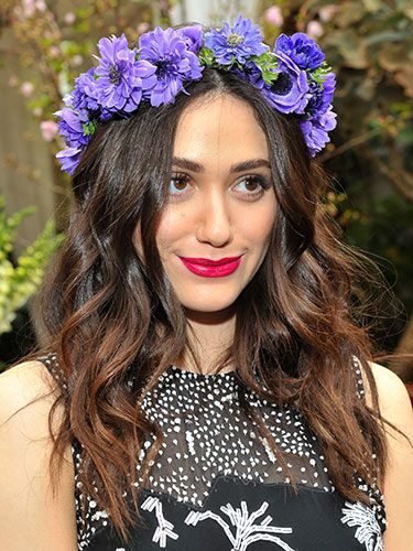 "<p>How's this for Coachella hair inspo? Emmy nailed hippy chic in LA with undone waves and a crown of flowers. Her vibrant magenta lip sealed the deal.</p> <p><a href=""http://www.cosmopolitan.co.uk/beauty-hair/news/trends/celebrity-beauty/lupita-nyong-for-lancome-pictures"" target=""_self"">SEE LUPITA NYONG'O AS THE FACE OF LANCOME</a></p> <p><a href=""http://www.cosmopolitan.co.uk/beauty-hair/news/trends/celebrity-beauty/beyonce-makeup-artist-sir-john-tips"" target=""_blank"">BEYONCE'S MAKEUP ARTIST SHARES HIS TIPS</a></p> <p><a href=""http://www.cosmopolitan.co.uk/beauty-hair/news/styles/celebrity/celebrity-bob-hairstyles"" target=""_blank"">THE BEST CELEBRITY BOB HAIRSTYLES</a></p>"