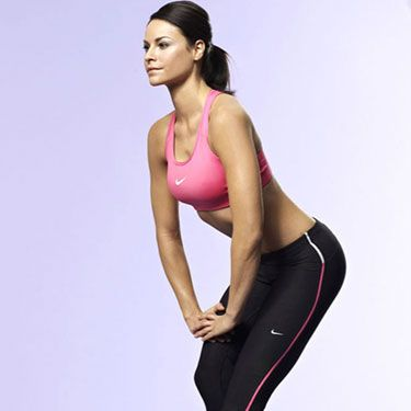 """<p>From standing, take a very short stride forwards with your left leg.</p><p>Keeping your left leg straight and staying as upright as possible, bend your rear right leg until you can feel a stretch through the back of your front leg.</p><p>Rest your hands on your bent leg and hold the stretch for 20 seconds before swapping.</p><p><a href=""""http://www.cosmopolitan.co.uk/diet-fitness/fitness/beat-muscle-soreness-with-a-warm-up"""" target=""""_blank"""">THE RIGHT WAY TO WARM UP</a></p><p><a href=""""http://www.cosmopolitan.co.uk/diet-fitness/fitness/the-fat-burning-workout"""" target=""""_blank"""">THE FAT BURNING WORKOUT</a></p><p><a href=""""http://www.cosmopolitan.co.uk/diet-fitness/fitness/20-minute-summer-workout"""" target=""""_blank"""">20 MINUTE SUMMER WORKOUT</a></p>"""