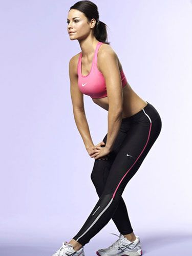 "<p>From standing, take a very short stride forwards with your left leg.</p> <p>Keeping your left leg straight and staying as upright as possible, bend your rear right leg until you can feel a stretch through the back of your front leg.</p> <p>Rest your hands on your bent leg and hold the stretch for 20 seconds before swapping.</p> <p><a href=""http://www.cosmopolitan.co.uk/diet-fitness/fitness/beat-muscle-soreness-with-a-warm-up"" target=""_blank"">THE RIGHT WAY TO WARM UP</a></p> <p><a href=""http://www.cosmopolitan.co.uk/diet-fitness/fitness/the-fat-burning-workout"" target=""_blank"">THE FAT BURNING WORKOUT</a></p> <p><a href=""http://www.cosmopolitan.co.uk/diet-fitness/fitness/20-minute-summer-workout"" target=""_blank"">20 MINUTE SUMMER WORKOUT</a></p>"