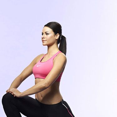 """<p>Stand upright, feet hip-width apart, hands on your hips.</p><p>Take a long stride forwards with your right leg and place your rear left knee on the floor.</p><p>Keeping your body upright, ease your hips forward to increase the stretch in your hip flexors.Hold for 20 seconds and then swap legs.</p><p><a href=""""http://www.cosmopolitan.co.uk/diet-fitness/fitness/beat-muscle-soreness-with-a-warm-up"""" target=""""_blank"""">THE RIGHT WAY TO WARM UP</a></p><p><a href=""""http://www.cosmopolitan.co.uk/diet-fitness/fitness/the-fat-burning-workout"""" target=""""_blank"""">THE FAT BURNING WORKOUT</a></p><p><a href=""""http://www.cosmopolitan.co.uk/diet-fitness/fitness/20-minute-summer-workout"""" target=""""_blank"""">20 MINUTE SUMMER WORKOUT</a></p>"""