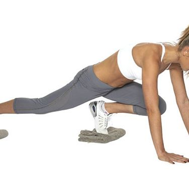 """<p><strong>Great for: A cardio burst. This multitasking move also strengthens your abdominals, chest, shoulders and legs.</strong></p><p>This should be done on a slippery floor - vinyl works well.</p><p>Start in the press-up position, with each foot resting on a small folded towelSlide your right knee up towards your chest, keeping your left leg extended and your back straight.</p><p>Slide your right leg back and repeat on the other side. This is one rep.</p><p>Moving as fast as you can, do 10-15 reps. Focus on keeping your hips steady and your abs pulled in.</p><p><a href=""""http://www.cosmopolitan.co.uk/diet-fitness/fitness/the-fat-burning-workout"""" target=""""_blank"""">SUPERCHARGE YOUR WORKOUT</a></p><p><a href=""""http://www.cosmopolitan.co.uk/diet-fitness/fitness/exercise-your-whole-body-with-Pixie-Lott-workout"""" target=""""_blank"""">TRAIN LIKE PIXIE LOTT</a></p><p><a href=""""http://www.cosmopolitan.co.uk/diet-fitness/fitness/flatten-your-stomach-with-pilates"""" target=""""_blank"""">GET A FLAT TUM WITH PILATES</a></p>"""
