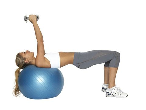 "<p><strong>Great for: Lengthening and strengthening your chest muscles while also working your bum and core.</strong></p> <p>Sit on a Swiss ball holding a pair of 3-6kg dumbbells. Roll down into a bridge position where your shoulders and head are supported by the ball, your hips are pushed up and your arms are straight above you.</p> <p>Keeping your abs engaged slowly lower the dumbbells to your side with a slight bend in your elbows.</p> <p>Breathing out, press the dumbbells back up above you. This is one rep, do 12-15. Make sure your elbows are lowering towards the floor first and that your wrists are straight.</p> <p><a href=""http://www.cosmopolitan.co.uk/diet-fitness/fitness/the-fat-burning-workout"" target=""_blank"">SUPERCHARGE YOUR WORKOUT</a></p> <p><a href=""http://www.cosmopolitan.co.uk/diet-fitness/fitness/exercise-your-whole-body-with-Pixie-Lott-workout"" target=""_blank"">TRAIN LIKE PIXIE LOTT</a></p> <p><a href=""http://www.cosmopolitan.co.uk/diet-fitness/fitness/flatten-your-stomach-with-pilates"" target=""_blank"">GET A FLAT TUM WITH PILATES</a></p>"