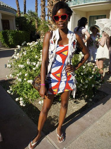 "<p>Top model, and Vivienne Westwood favourite, Tolula Adyemi looked gorgeous at the Soho House Pop-Up Party with Bacardi during Coachella. Wearing a Vivienne Westwood dress (surprise surprise!) teamed with a pair of fabulous heart shaped sunglasses.</p> <p><em>All Cosmo Street Style pictures were taken with a Nikon COOLPIX S9500. For more information visit <a title=""Nikon"" href=""http://www.Nikon.co.uk"" target=""_blank"">Nikon.co.uk</a></em></p> <div style=""overflow: hidden; color: #000000; background-color: #ffffff; text-align: left; text-decoration: none;""> </div>"
