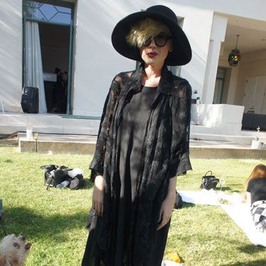<p>Fierce by name, fierce by nature! DJ Whitney Fierce stood out in her all black ensemble of Baby Alpaca kimono and Topshop Boutique dress. And check out her cute pooch Huxley T Waterhouse! Love.</p>