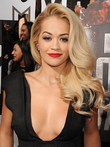 "<p>Rita Ora gets double points for this red carpet look - bold, red lip + deep, loose waves = Hollywood superstar. </p> <p><a href=""http://www.cosmopolitan.co.uk/fashion/celebrity/MTV-Movie-Awards-2014-rihanna-rita-ora-red-carpet"" target=""_blank"">MTV MOVIE AWARDS 2014: RED CARPET LOOKS</a></p> <p><a href=""http://www.google.co.uk/url?sa=t&rct=j&q=&esrc=s&source=web&cd=6&cad=rja&uact=8&ved=0CEoQFjAF&url=http%3A%2F%2Fwww.cosmopolitan.co.uk%2Fcelebs%2Fentertainment%2Foscars-2014-red-carpet-arrivals-live-stream&ei=-ARMU6rsEdSV7AbJ24GIDQ&usg=AFQjCNHAjMIOQ_R-jxQVHnzYzfGtg-NJAQ&bvm=bv.64542518,d.d2k"" target=""_blank"">OSCARS 2014 RED CARPET LIVE</a></p> <p><a href=""http://www.google.co.uk/url?sa=t&rct=j&q=&esrc=s&source=web&cd=9&cad=rja&uact=8&ved=0CF8QFjAI&url=http%3A%2F%2Fwww.cosmopolitan.co.uk%2Fbeauty-hair%2Fnews%2Ftrends%2Fcelebrity-beauty%2Fcelebrity-beauty-prep-baftas-2014&ei=-ARMU6rsEdSV7AbJ24GIDQ&usg=AFQjCNHaJzJcqXXOCWwO26B2vH1h_C4bqw&bvm=bv.64542518,d.d2k"" target=""_blank"">THE EXTENSIVE PRE-BAFTAS BEAUTY PREP</a></p>"