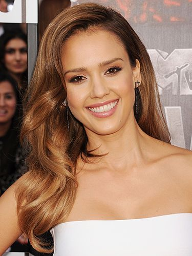 "<p>Screaming California vibes with that glossy, tawny tan, Jessica Alba works bouncy hair with sheer, natural hues. Dreamy. </p> <p><a href=""http://www.cosmopolitan.co.uk/fashion/celebrity/MTV-Movie-Awards-2014-rihanna-rita-ora-red-carpet"" target=""_blank"">MTV MOVIE AWARDS 2014: RED CARPET LOOKS</a></p> <p><a href=""http://www.google.co.uk/url?sa=t&rct=j&q=&esrc=s&source=web&cd=6&cad=rja&uact=8&ved=0CEoQFjAF&url=http%3A%2F%2Fwww.cosmopolitan.co.uk%2Fcelebs%2Fentertainment%2Foscars-2014-red-carpet-arrivals-live-stream&ei=-ARMU6rsEdSV7AbJ24GIDQ&usg=AFQjCNHAjMIOQ_R-jxQVHnzYzfGtg-NJAQ&bvm=bv.64542518,d.d2k"" target=""_blank"">OSCARS 2014 RED CARPET LIVE</a></p> <p><a href=""http://www.google.co.uk/url?sa=t&rct=j&q=&esrc=s&source=web&cd=9&cad=rja&uact=8&ved=0CF8QFjAI&url=http%3A%2F%2Fwww.cosmopolitan.co.uk%2Fbeauty-hair%2Fnews%2Ftrends%2Fcelebrity-beauty%2Fcelebrity-beauty-prep-baftas-2014&ei=-ARMU6rsEdSV7AbJ24GIDQ&usg=AFQjCNHaJzJcqXXOCWwO26B2vH1h_C4bqw&bvm=bv.64542518,d.d2k"" target=""_blank"">THE EXTENSIVE PRE-BAFTAS BEAUTY PREP</a></p>"